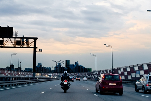 Economists and travel experts say  Labor Day, as usual, will see many Americans taking to the roads and the air.