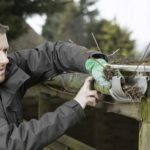 Clean out the gutters is one of several ways to winterize your home when you're gone for the season.