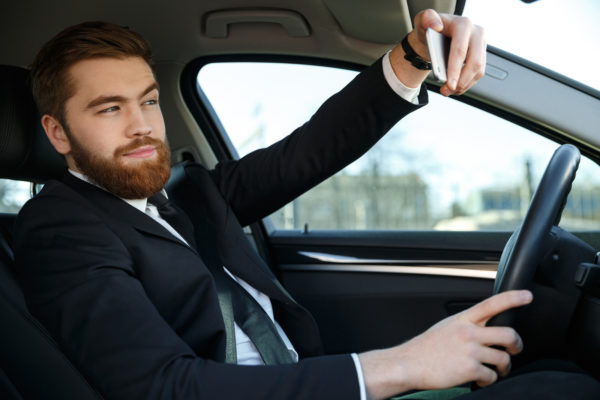 Selfies while driving are increasingly becoming danger on the roads.